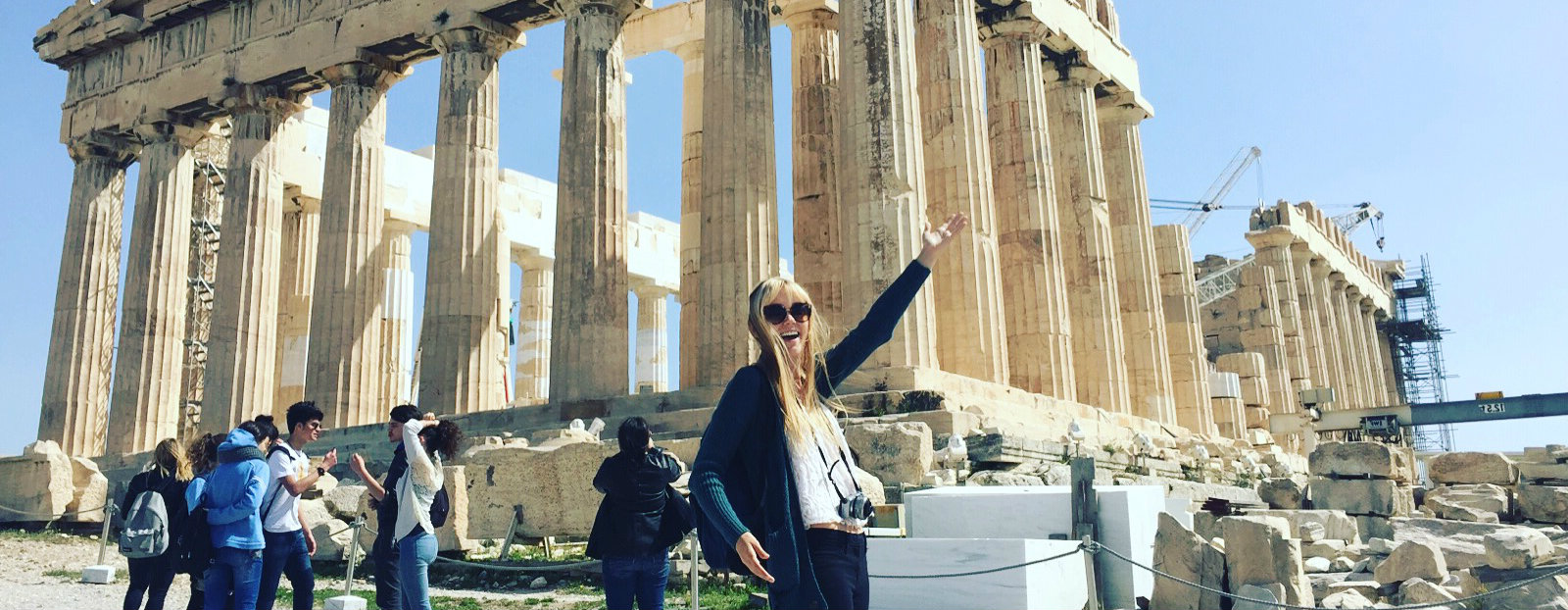 Girl in front of the Parthenon in Greece
